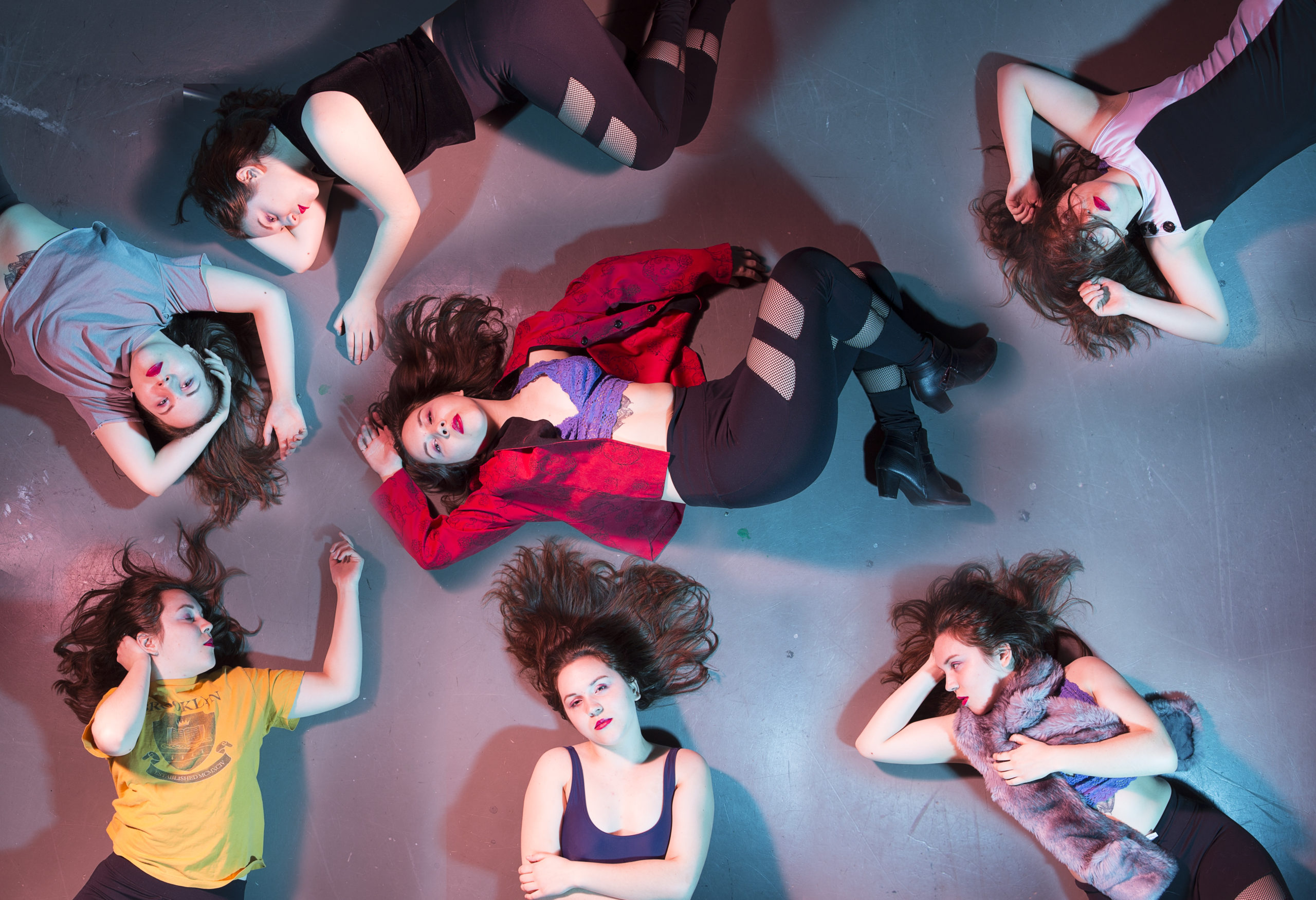 """Inspired by Beatrice eli's music video for """"girls"""" this image sepicts the artist in a variety of different """"party"""" outfits, lying on the floor, shot from a bird's eye view,"""